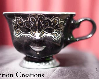 147 - Silver and Gold Dot Mask on Black Background Ceramic Doll Face Tea Cup