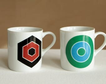 Vintage white ceramic cups with geometric designs - hexagon and circle targets
