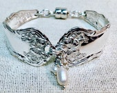 Reserved 1908 Spoon Bracelet from Arbutus silverware pattern.