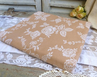 One piece of french vintage rose beige mattress ticking with white roses. Peach french mattress ticking fabric for craft projects.