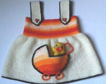 Knitted warm and soft sundress for baby