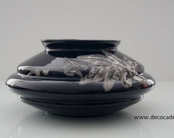 Flat black vase from the Doyen glass factory, decorated with a pewter herd of tree leaves.