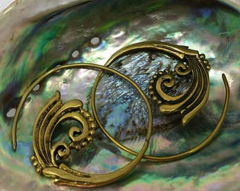 Brass hoop earrings with decorative swirls and dots.