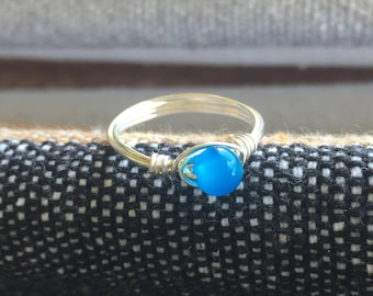 Ring size 8 - Electric blue bead with silver tone wire