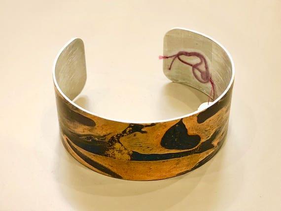 Enamel painted aluminum cuff open bracelet with abstract design (orange, blue)