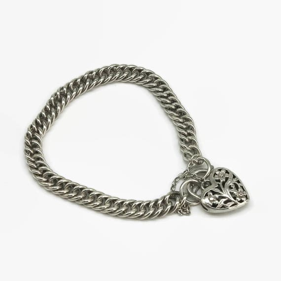Sterling silver curb link bracelet with large filigree heart closure with floral pattern, safety chain, substantial, 28 grams, stamped 925