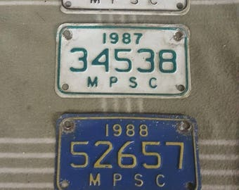 3 Vtg 1986/87/88 MPSC Michigan Public Service Motorcycle License Plate. Harley