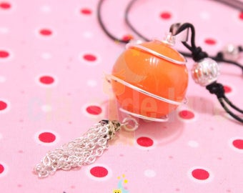 Pregnancy's Bola Harmonyball genuine orange encased in a sphere and tassel