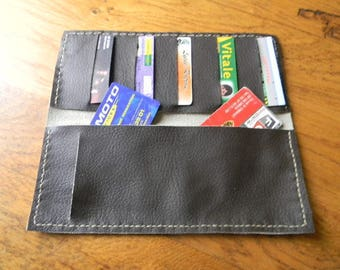 Checkbook and brown/white leather card holder