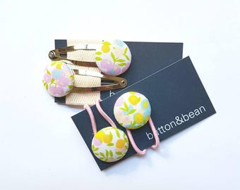 Floral fabric snap clips and hair ties sets in beautiful Liberty of London. 23mm fabric covered buttons.