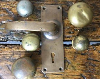 Antique vintage brass and bronze door handles. Old English solid brass door handle. Display props.