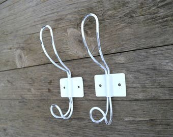A pair of vintage French cafe style worn white steel coathooks coat hook hanger rack