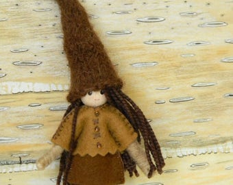 small girl elf bendy doll dressed in brown