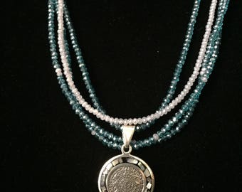 Multi strand necklace with Aztec sterling silver and mother of pearl pendant