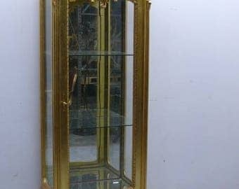 Narrow vitrine in the Baroque style, golden
