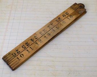 Vintage wooden folding ruler or measuring stick