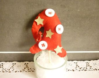 Red Pixie tree with white buttons and gold stars.