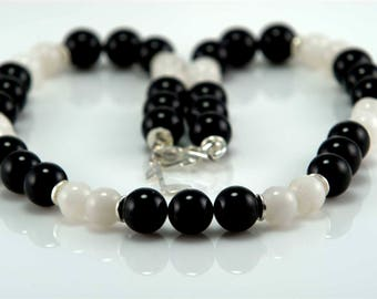 Necklace made with black onyx and white agate beads.