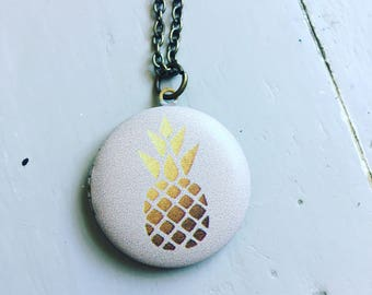 Gold pineapple locket necklace