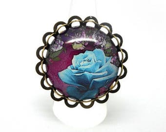 Ring bronze cabochon pink glass blue on purple background with charms and co.