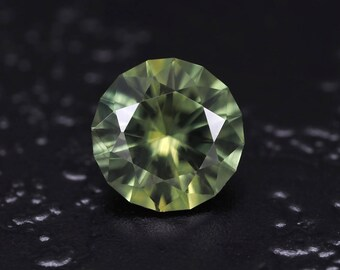 0.88 ct Natural Green Sapphire from Madagascar. Round brilliant cut. Clean, loose gemstone. Precision faceting