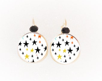Earrings cabochon silver stars on white background