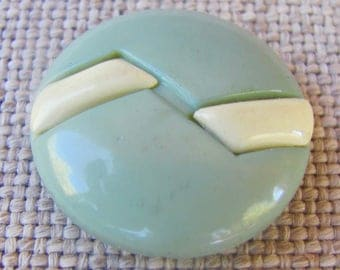 Blumenthal Backmark: Blue/Green and White Celluloid Button With Blumenthal Backmark