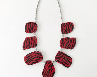 Welcome to the jungle. Black and red animal print statement necklace - handmade with polymer clay