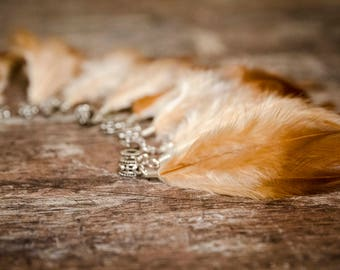Dread beads with blonde-foxy feathers