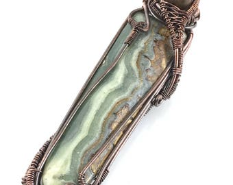 Wavellite gemstone pendant with Petrified Wood, wire wrapped in copper. Clearing Ancestral Karma