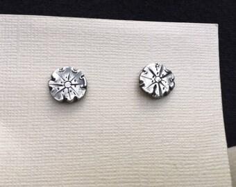 Sterling silver flower post earrings.