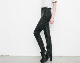 Black genuine leather motorcycle pants . Lace up leg detail . Heavy metal . Rock'n'roll biker pants . 1990s . size S .