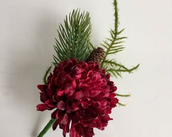 A burgundy, winter buttonhole