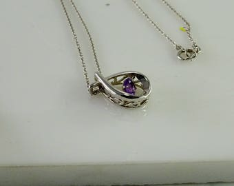 "Sterling Floating Purple Stone Pendant on a 17"" Chain"
