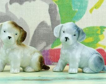 Pair of very sweet vintage ceramic dog figurines, one brown markings, one grey markings.