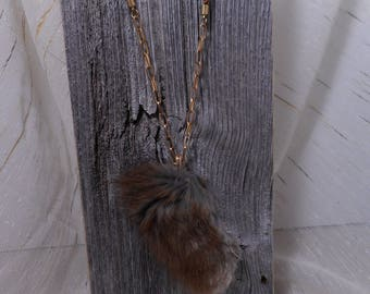 Long necklace with recycled muskrat fur.