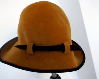 1960s velvet cloche in mustard with a black rolled up brim