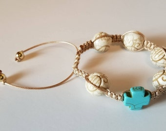 2 adjustable bracelets with a cross and stones