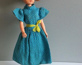 Sindy blue polka dot dress, need of TLC.