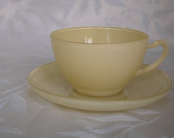 Vintage pastel yellow cup and saucer