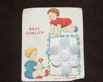 7 Vintage French baby white plastic shank buttons on original card 11mm #25