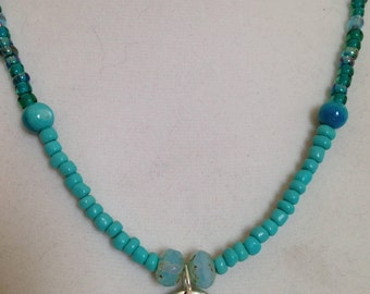 Beach ready turquoise  glass bead necklace with a starfish