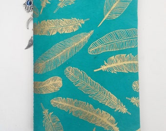 Notebook - Daughter of Smoke and Bone Karou and Akiva turquoise and gold feather cover and hamsa, wishbone and angel wing charms