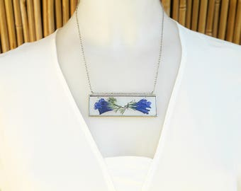 Pendant with natural wild flowers. Purple elegance!