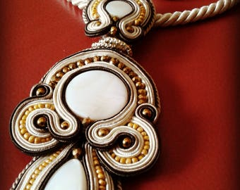 Soutache pendant. Ideal to use as a light to a dark-toned clothing. Lightweight, convenient and elegant to wear
