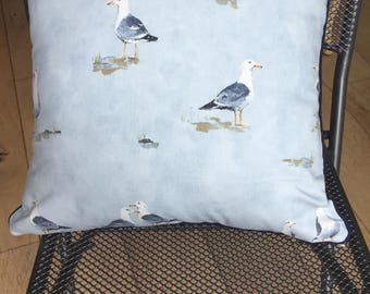 Beautiful Seaside themed scatter cushion with seagull print in periwinkle blue.  Contrasting navy piping and invisible zip