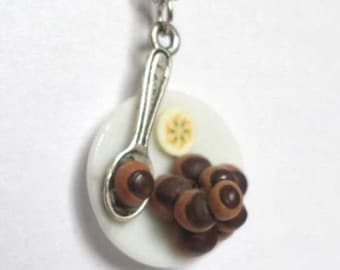 Necklace chocolate confection and slice of banana Fimo