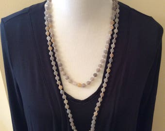 Handknotted necklace made of grey & brown agate beads with a matte finish. This necklace is long enough to be worn as a double strand.