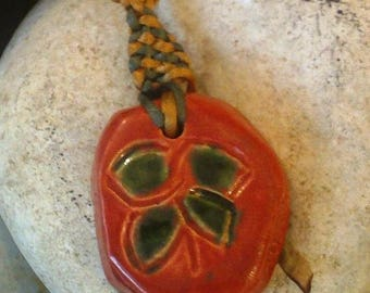 Pendant made of clay with a clover four leaf