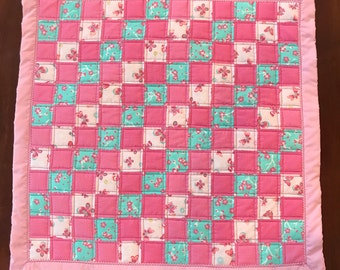 Small baby quilt in pink and teal with butterflies